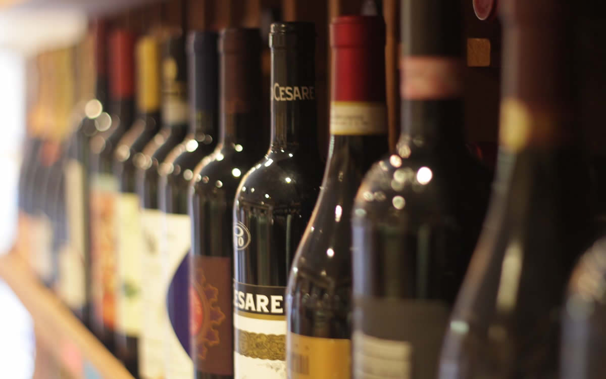 Close-Up of Wine Bottles on Shelf